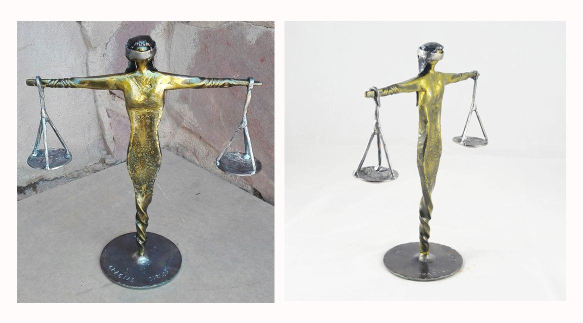 Dama de la justicia en forja